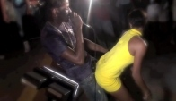 Aidonia performing with a female fan at Uwi Freshers Fete